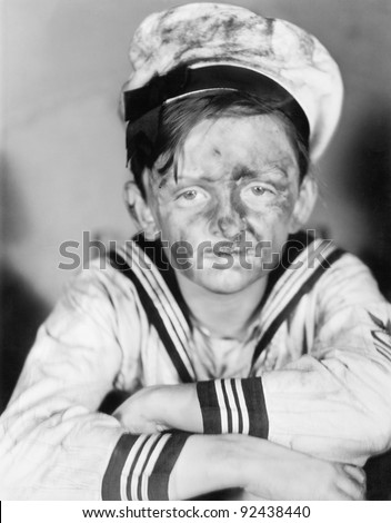Boy in his sailors  outfit with dirty face