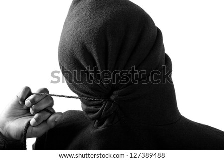boy in hoodie with his face fully covered - stock photo