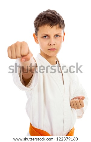 Boy in kimono making punch isolated over white background