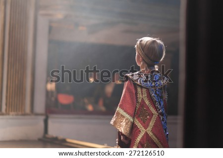 boy in medieval costume acting  - stock photo