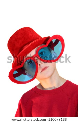 Boy In Red Hat And Heart Glasses Vertical - stock photo