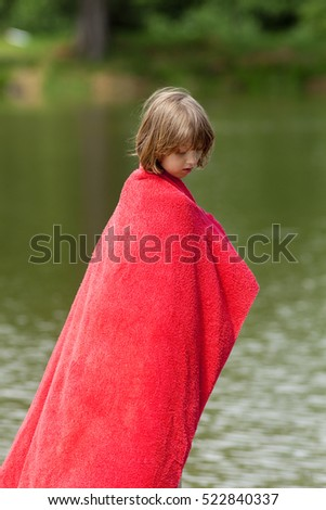Boy in Red Towel Standing on Jetty by a Lake