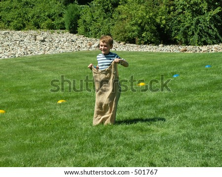boy in sack race - stock photo