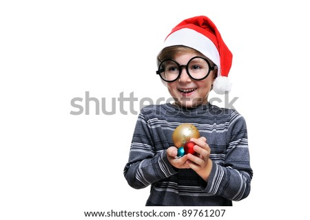 Boy in Santa hat holding Christmas decorations in hand isolated on white background - stock photo