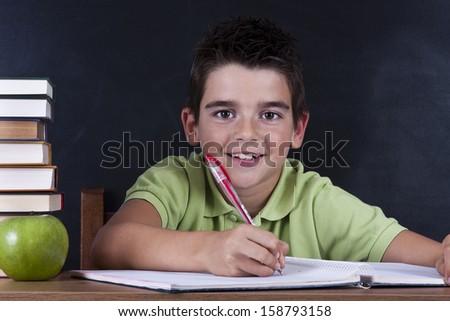 boy in school desk - stock photo