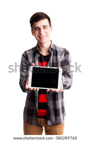 Boy in shirt hold tablet selective focus isolated on white - stock photo