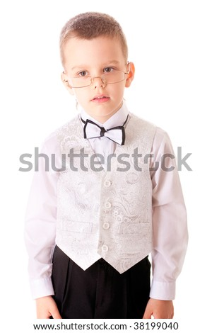 Boy in suit with butterfly and in glasses, is isolated on white background.