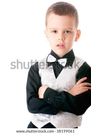 Boy in suit with butterfly, is isolated on white background.