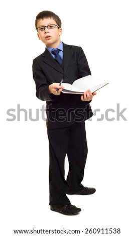 boy in suit with pen and book point at - stock photo