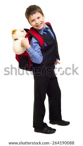 boy in suit with red backpack on white - stock photo