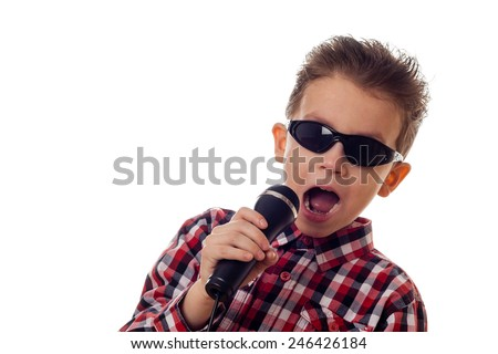 boy in sunglasses and checkered shirt yelling in microphone - stock photo