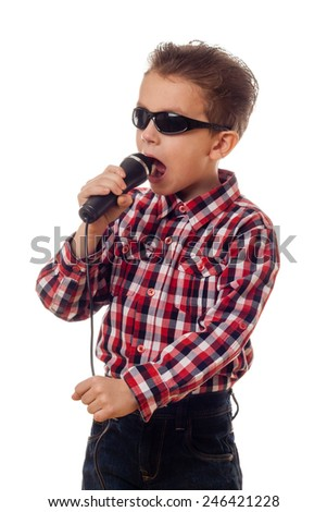 boy in sunglasses checkered shirt and jeans singing - stock photo