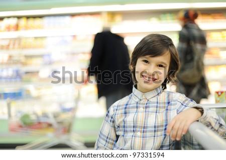 Boy in supermarket - stock photo