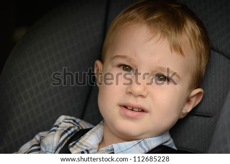 Boy in the car seat - stock photo