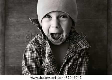 boy in the hat shouted, black and white photography - stock photo