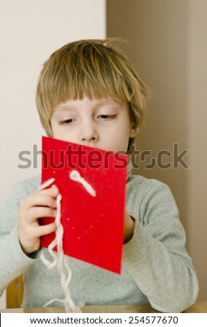 boy in the heart of embroidery - stock photo