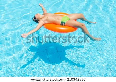 Boy in the pool. Photo for microstock - stock photo