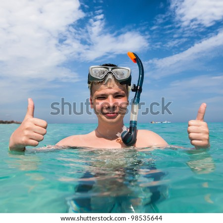 boy in the sea on a beach - stock photo