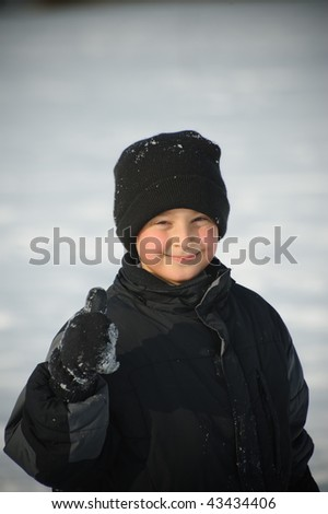 Boy in the winter - stock photo