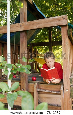 Boy in tree fort - stock photo