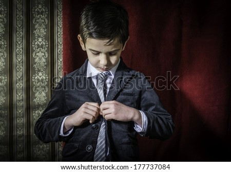 Boy in vintage black suit and tie