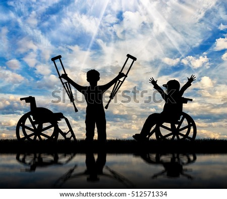 Boy in wheelchair and disabled boy standing with crutches near sea and reflection. Concept disabled child