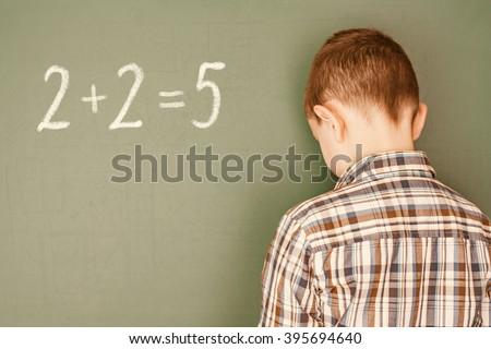 Boy incorrectly decisive simple mathematical example - stock photo