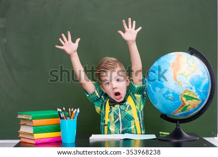 Boy indulges in class. - stock photo