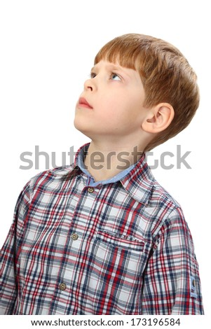 Boy intently looking up isolated on white background