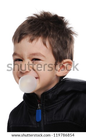 Boy is blowing a bubble - stock photo