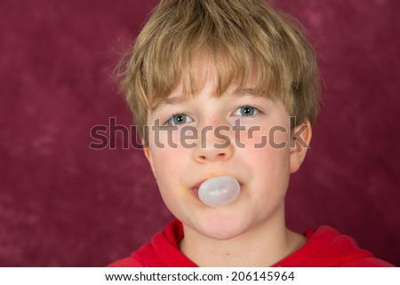 boy is blowing bubble - stock photo