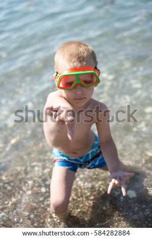 Boy is having fun with diving mask