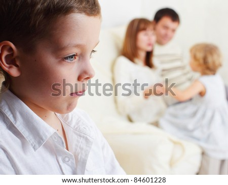 Boy is jealous parents of younger sister - stock photo