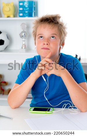boy is listening music with smartphone - stock photo