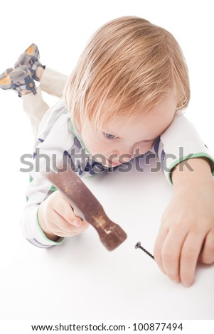 boy is looking at hammer and nail, isolated on a white