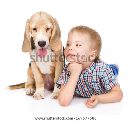 boy is lying near a puppy. isolated on white background - stock photo