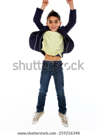 Boy jumping in studio isolated on white. - stock photo