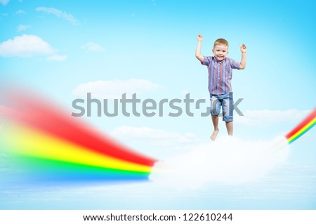 boy jumping on clouds and a rainbow, collage, place for text