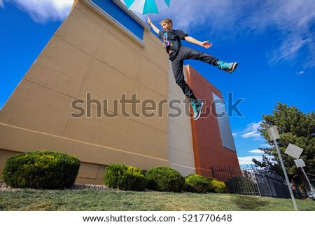 boy jumping with umbrella