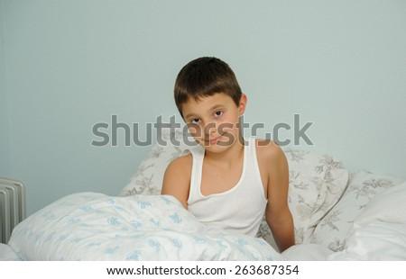Boy just woke up - stock photo