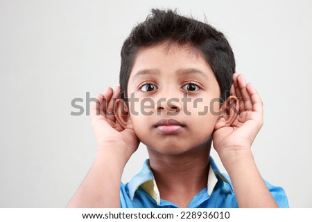 Boy keen on listening to a low voice - stock photo