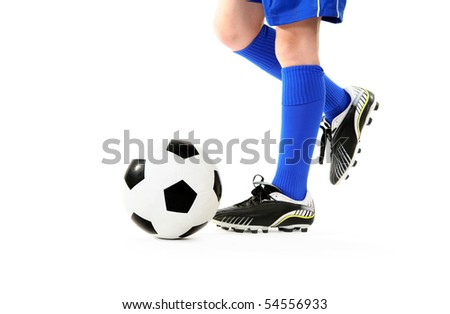 Boy kicking a soccer ball.  White background. - stock photo