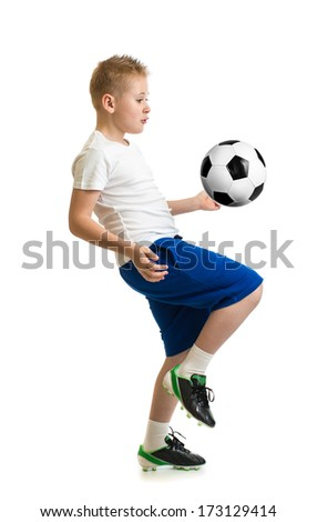 Boy kicking soccer ball by knee isolated on white. Training exercise. - stock photo