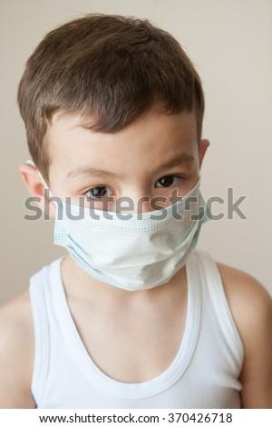 boy kid epidemic flu medicine child  medical mask - stock photo
