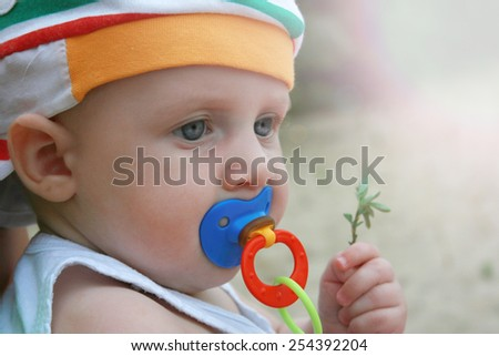 boy kid six-month baby little child nature summer blurred background - stock photo