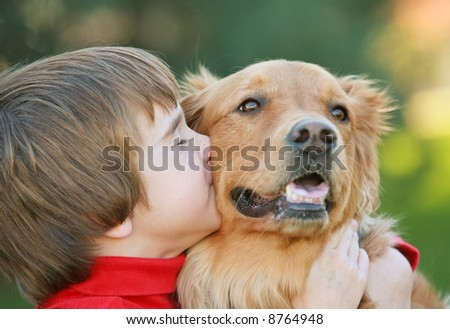 Boy Kissing Dog - stock photo