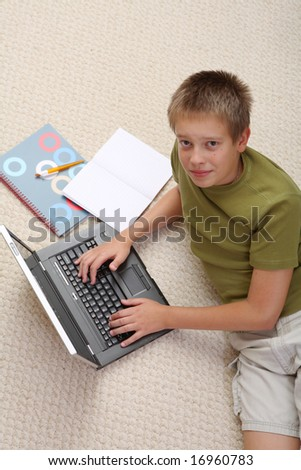 Boy learning at home with notebook