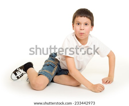boy lie on white studio isolated