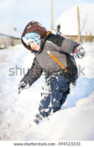Boy lies on snow and posing