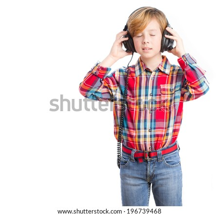 Boy listening music with an headphones - stock photo